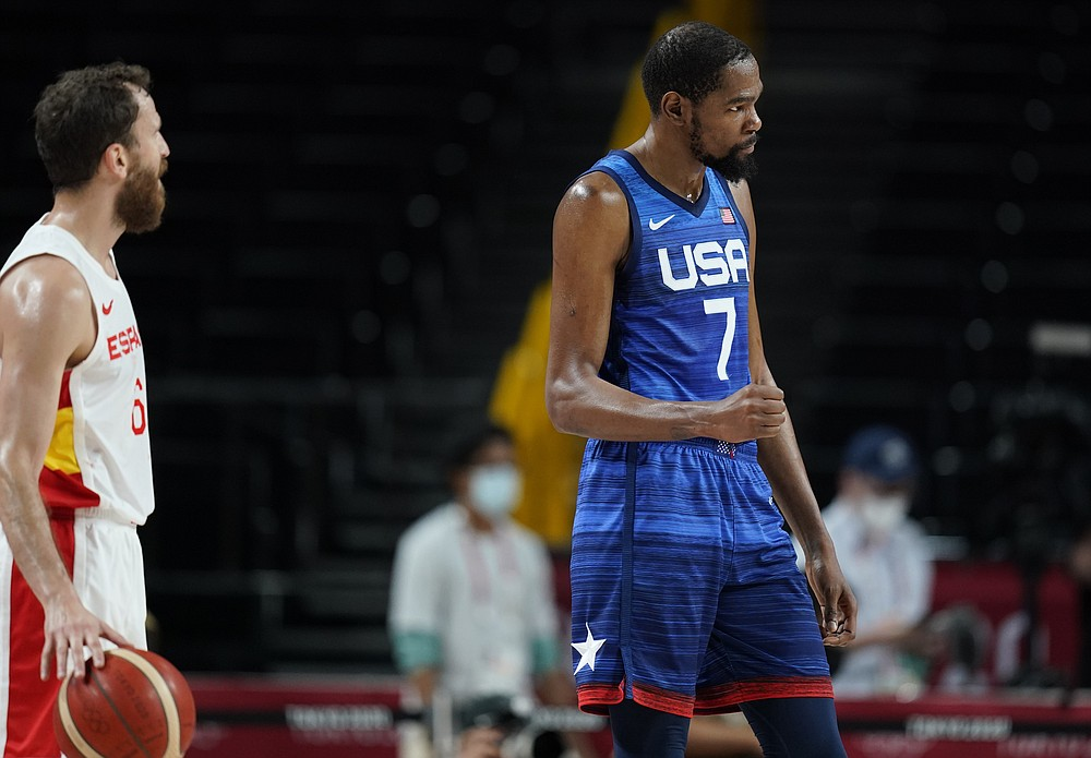 United States' Kevin Durant (7), right, reacts to celebrate their win in the men's basketball quarterfinal game against Spain at the 2020 Summer Olympics, Tuesday, Aug. 3, 2021, in Saitama, Japan. (AP Photo/Charlie Neibergall)
