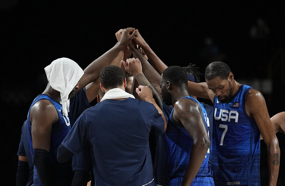 United States' Kevin Durant (7), right, and teammates celebrate their win in the men's basketball quarterfinal game against Spain at the 2020 Summer Olympics, Tuesday, Aug. 3, 2021, in Saitama, Japan. (AP Photo/Eric Gay)