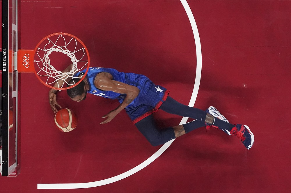 United States' Kevin Durant scrambles for a loose ball during a men's basketball quarterfinal game against Spain at the 2020 Summer Olympics, Wednesday, July 28, 2021, in Saitama, Japan. (Brian Snyder/Pool Photo via AP)