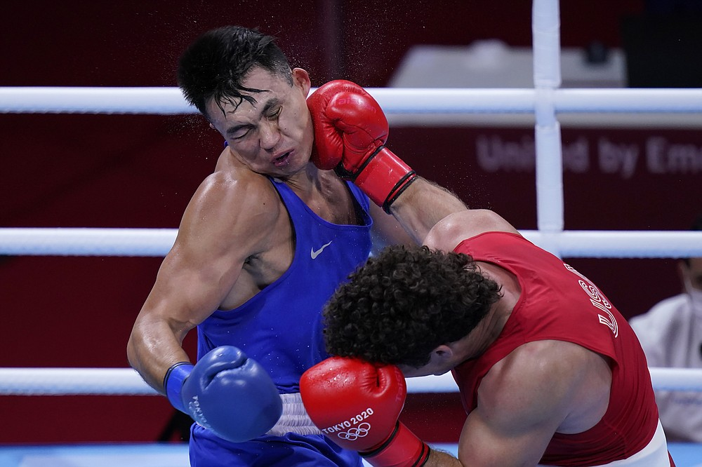 Richard Torrez Jr., of the United States, right, lands a shot to the face of Kamshybek Kunkabayev, of Kazakhstan, during their super heavy weight +91kg semifinal boxing match at the 2020 Summer Olympics, Wednesday, Aug. 4, 2021, in Tokyo, Japan. (AP Photo/Frank Franklin II)