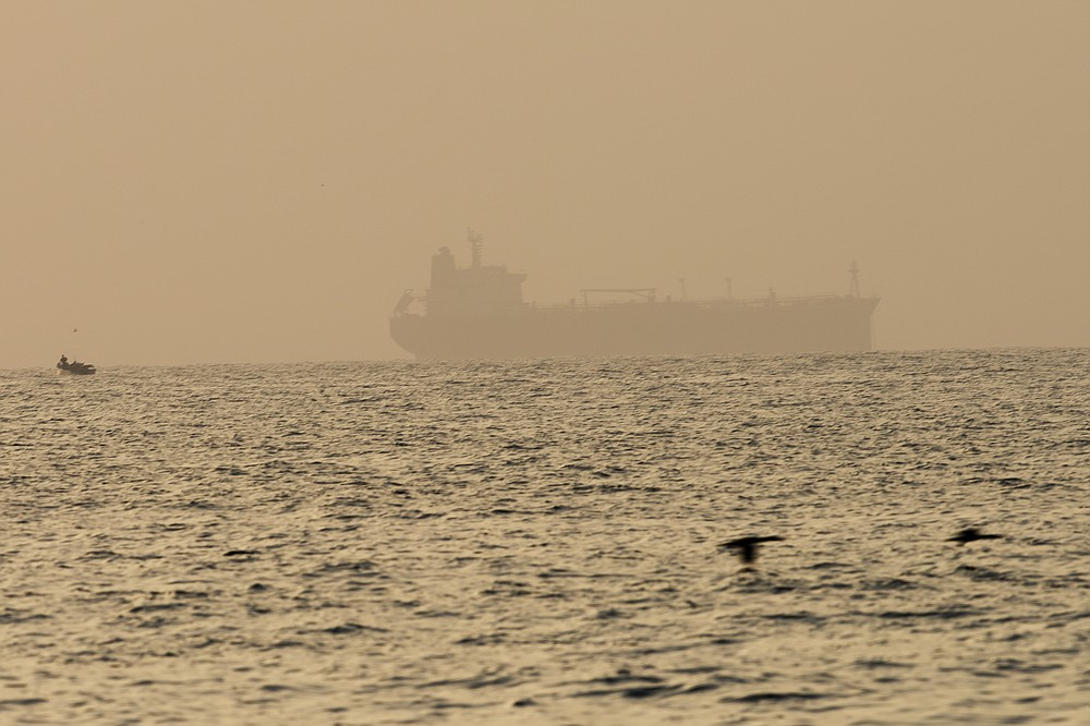 """The oil tanker Mercer Street, which came under attack last week off Oman, is seen moored off Fujairah, United Arab Emirates, Wednesday, Aug. 4, 2021. The British navy warned of a """"potential hijack"""" of another ship off the coast of the United Arab Emirates in the Gulf of Oman on Tuesday, though the circumstances remain unclear. (AP Photo/Jon Gambrell)"""