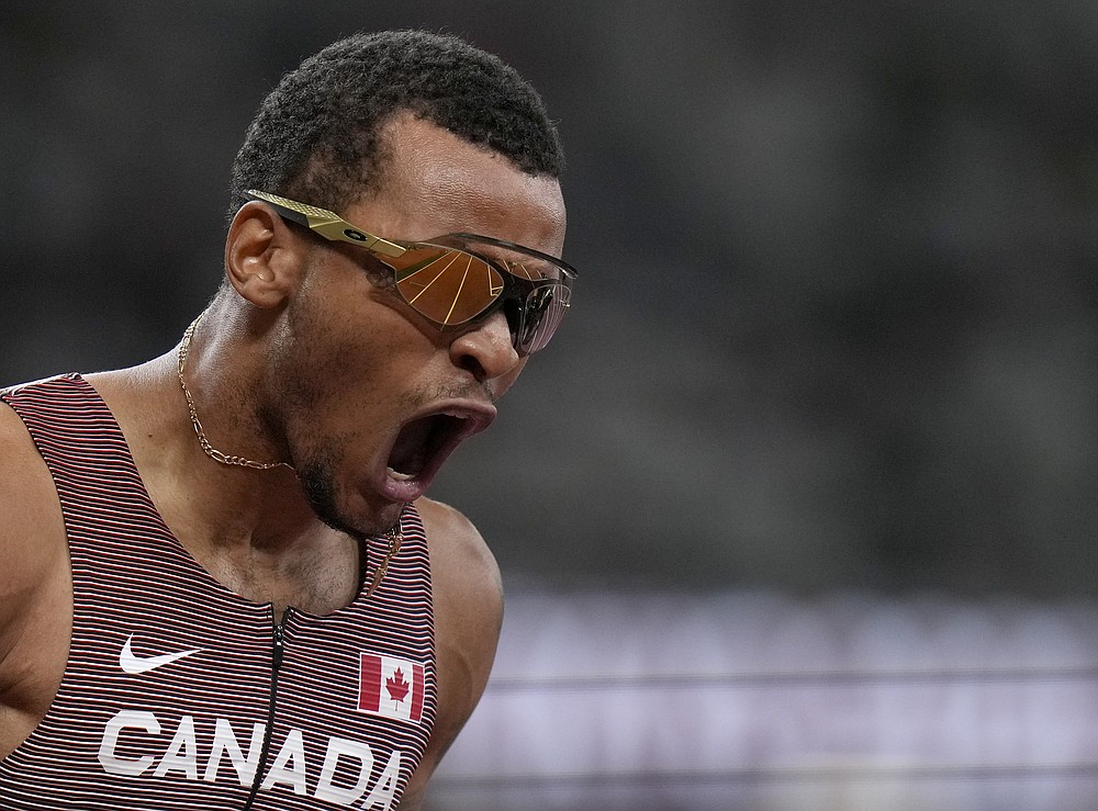 Andre De Grasse, of Canada celebrates after he won the gold medal in the final of the men's 200-meters at the 2020 Summer Olympics, Wednesday, Aug. 4, 2021, in Tokyo, Japan. (AP Photo/Francisco Seco)