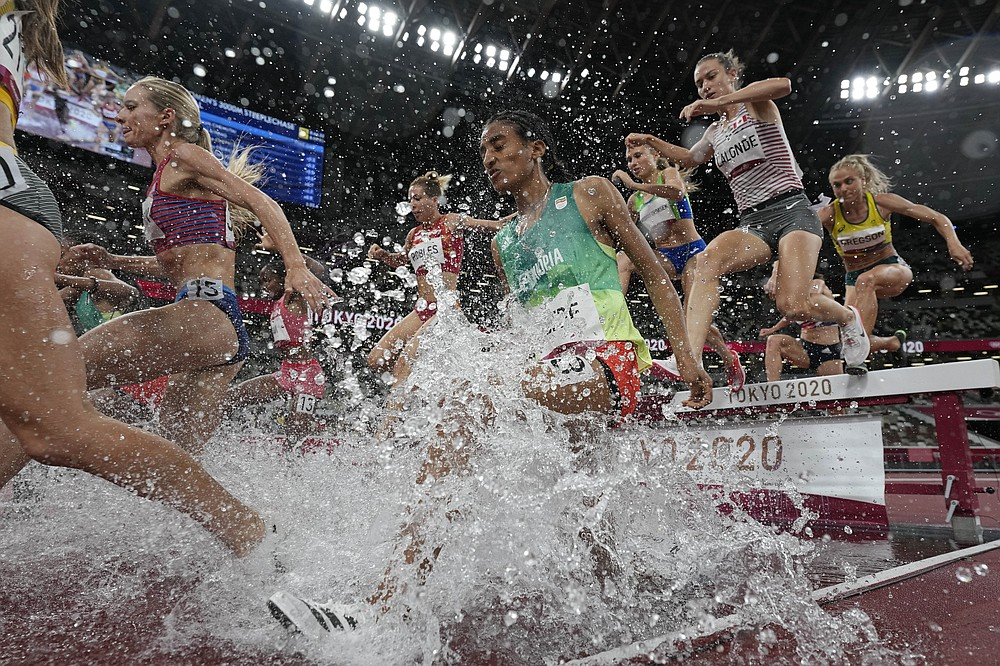 Runners compete in the final of the women's 3,000-meters steeplechase at the 2020 Summer Olympics, Wednesday, Aug. 4, 2021, in Tokyo. (AP Photo/David J. Phillip)