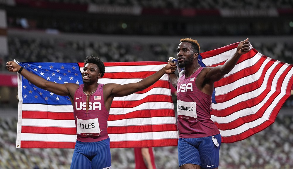 Kenneth Bednarek, of United States, silver, and Noah Lyles, of United States, bronze, react after the final of the men's 200-meters at the 2020 Summer Olympics, Wednesday, Aug. 4, 2021, in Tokyo, Japan. (AP Photo/Francisco Seco)