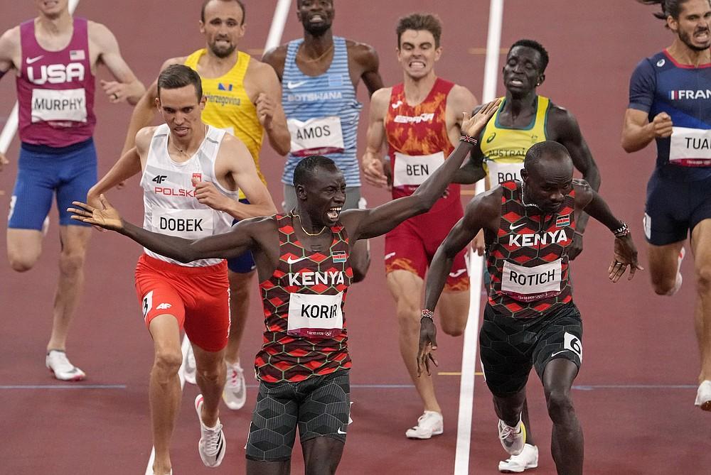 Emmanuel Korir, of Kenya, celebrates as he wins the gold medal ahead of Ferguson Rotich, of Kenya in the final of the men's 800-meter at the 2020 Summer Olympics, Wednesday, Aug. 4, 2021, in Tokyo, Japan. (AP Photo/Charlie Riedel)