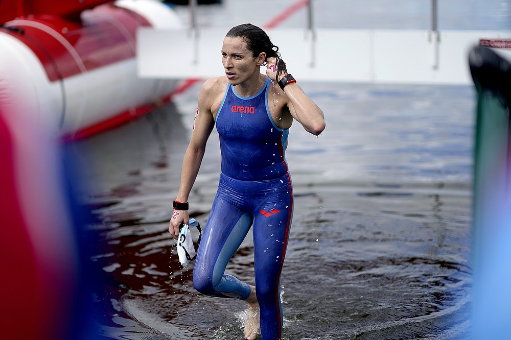 Souad Nefissa Cherouati, of Algeria, exits the water after finishing the women's marathon swimming event at the 2020 Summer Olympics, Wednesday, Aug. 4, 2021, in Tokyo. (AP Photo/David Goldman)