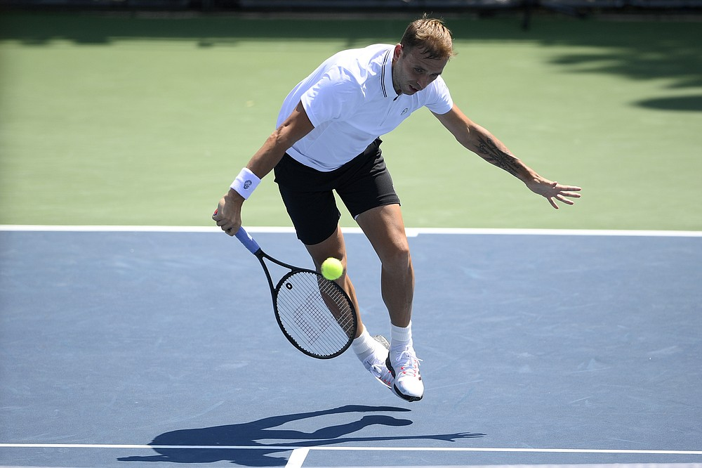 Daniel Evans, of England, lunges for the ball during a match against Brandon Nakashima in the Citi Open tennis tournament, Wednesday, Aug. 4, 2021, in Washington. (AP Photo/Nick Wass)