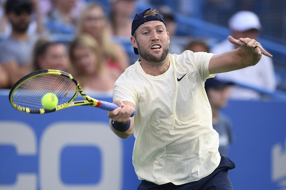 Jack Sock, of the United States, hits a forehand to Rafael Nadal, of Spain, at the Citi Open tennis tournament Wednesday, Aug. 4, 2021, in Washington. (AP Photo/Nick Wass)