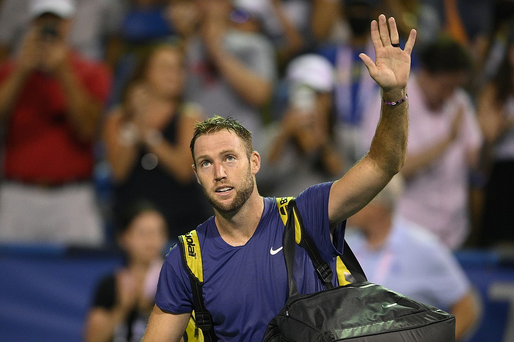 Jack Sock, of the United States, waves to the crowd after a loss to Rafael Nadal, of Spain, in the Citi Open tennis tournament Wednesday, Aug. 4, 2021, in Washington. (AP Photo/Nick Wass)