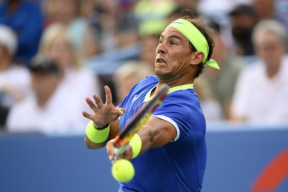 Rafael Nadal, of Spain, returns a shot to Jack Sock, of the United States, at the Citi Open tennis tournament Wednesday, Aug. 4, 2021, in Washington. (AP Photo/Nick Wass)