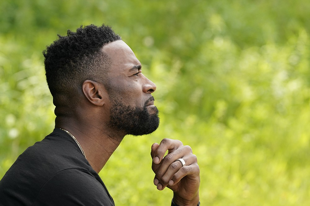Calvin Johnson is interviewed in Webberville, Mich., Friday, June 4, 2021. Former Detroit Lions wide receiver Calvin Johnson, to be inducted into the Pro Football Hall of Fame on Aug. 8, has founded a cannabis business and is collaborating with Harvard University to research how marijuana can help people with CTE and chronic pain. (AP Photo/Carlos Osorio)