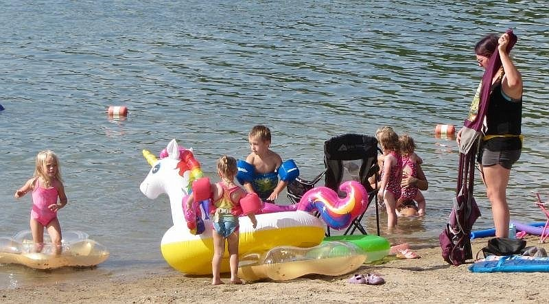 Toys are popular at the beach by Three Sisters Springs at Lake Ouachita State Park. (Special to the Democrat-Gazette/Marcia Schnedler)