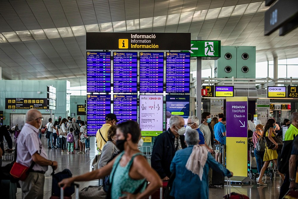 Passengers wait in the departures hall at El Prat airport in Barcelona, Spain, on Aug. 2. (Bloomberg/Angel Garcia)