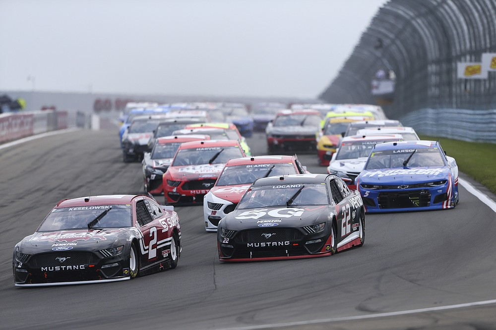 Brad Keselowski (2) and Joey Logano (22) lead the field around Turn 1 on the first lap of a NASCAR Cup Series car race in Watkins Glen, NY on Sunday August 8, 2021. (AP Photo / Joshua Bessex)