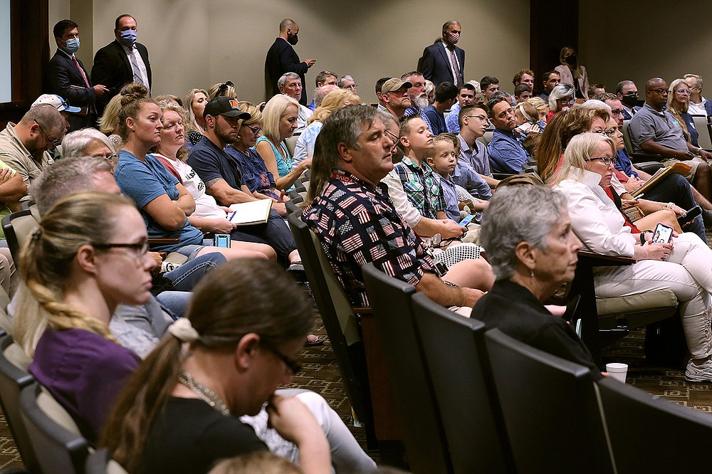 A large crowd of people watch during a meeting of the joint House and Senate Committee on Insurance and Commerce on Tuesday, Aug. 10, 2021, at the state Capitol in Little Rock.  (Arkansas Democrat-Gazette/Thomas Metthe)