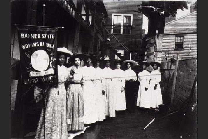 President Nannie Burroughs, flanked by female colleagues, holds a banner at the 1910 National Baptist Convention's Women's Convention. (Special to the Democrat-Gazette/Library of Congress)