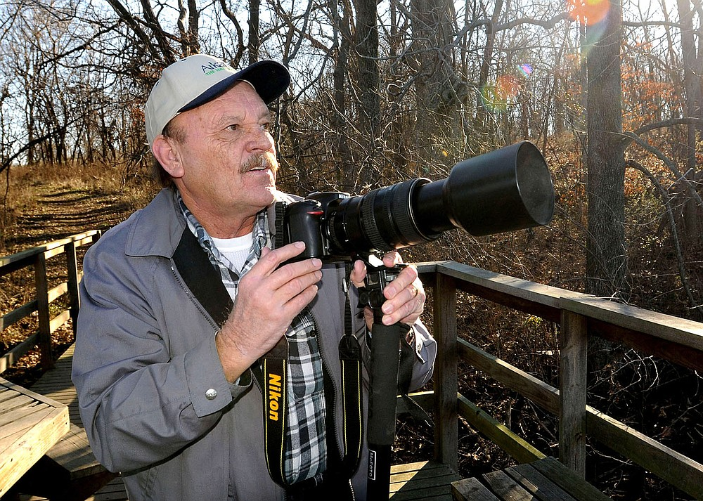 NWA Democrat-Gazette/FLIP PUTTHOFF Terry Stanfill photographs bald eagles Jan. 14, 2016, at SWEPCO Lake along the Eagle Watch Nature Trail near Gentry. Stanfill, of rural Gentry, is caretaker of the trail located near the Flint Creek Power Plant. Many of his nature photos are taken on the trail.