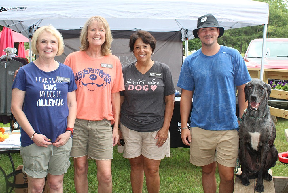Desi Keel (from left), Carla Hodges, Alison Kimbrough, Humane Society of the Ozarks board members; Chase Jackson, executive director; and Tusk welcome guests to Dog Days of Summer on Aug. 1. (NWA Democrat-Gazette/Carin Schoppmeyer)