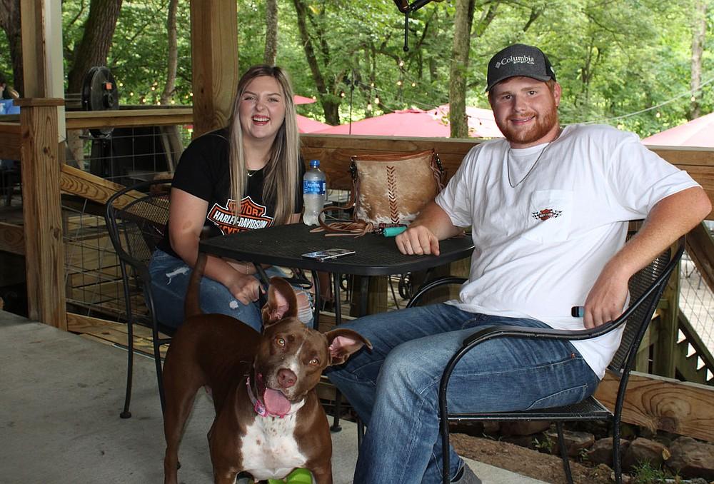 Katie Harms and Kole Fairchild, with Savi, enjoy the Dog Days of Summer.  (NWA Democrat-Gazette/Carin Schoppmeyer)