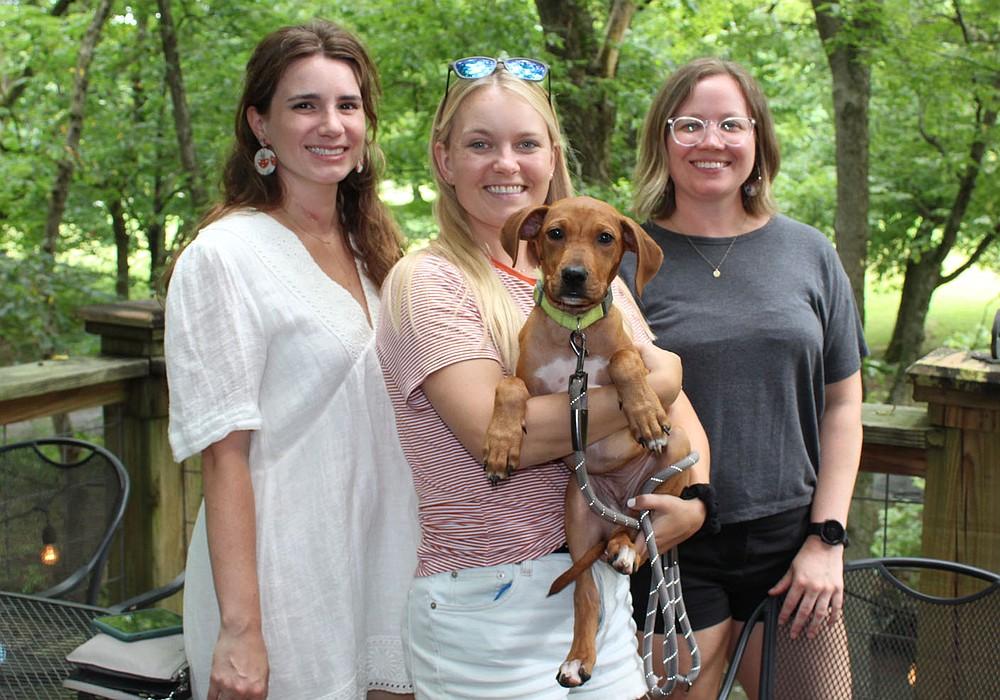 Megan Wein (from left), Laine Zammit, Hatch and Lacey Garrison help support the Humane Society of the Ozarks on Aug. 1. (NWA Democrat-Gazette/Carin Schoppmeyer)