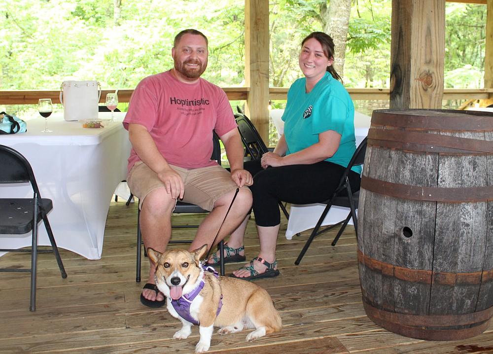 Evan and Mekenzie Wilkerson, with Koala, attend Dog Days of Summer.  (NWA Democrat-Gazette/Carin Schoppmeyer)