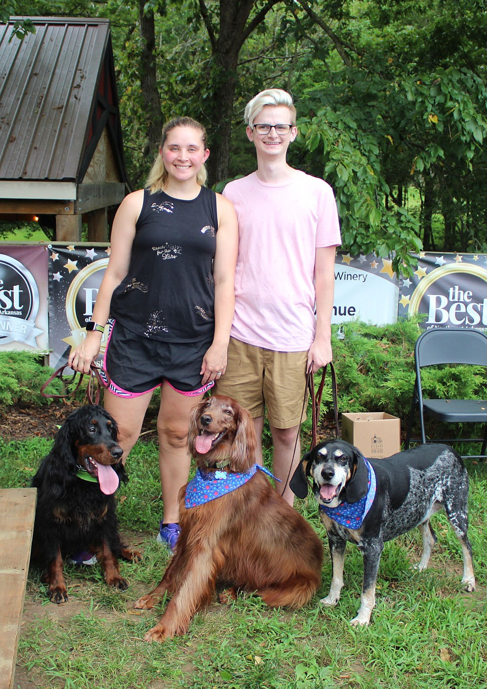 Kara and Brad Nickell help support the Humane Society with Ruby (from left), Arthur and Handsome on Aug. 1.  (NWA Democrat-Gazette/Carin Schoppmeyer)