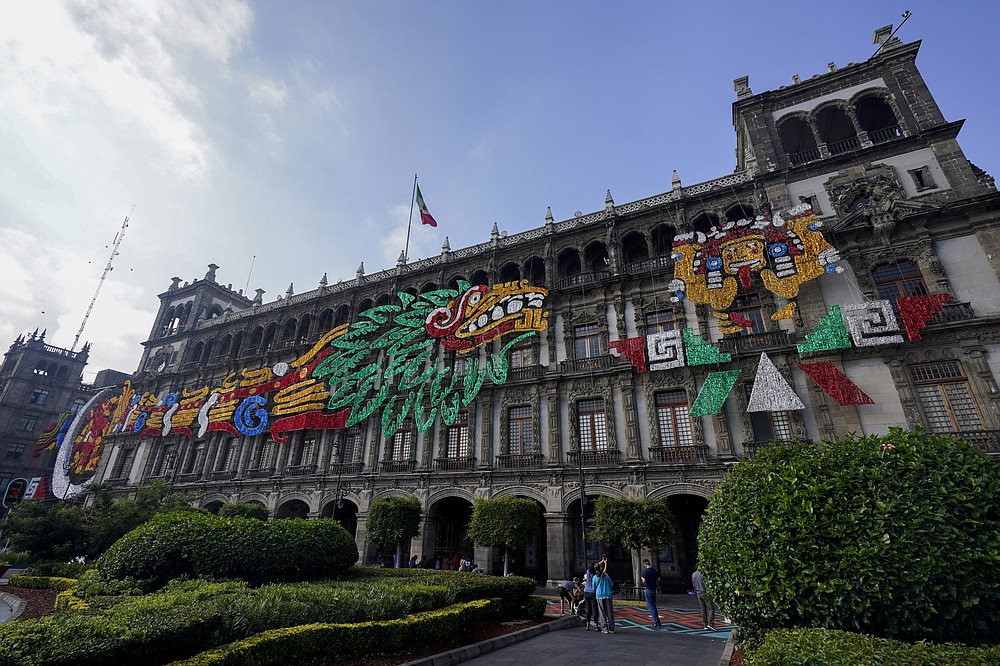 An image of the Pre-columbian god Quetzalcoatl adorns a building at Mexico City´s main square the Zocalo, Monday, Aug. 9, 2021. Mexico City is preparing for the 500 anniversary of the fall of the Aztec capital of Tenochtitlan, today´s Mexico City, on Aug. 13, 2021. (AP Photo/Eduardo Verdugo)