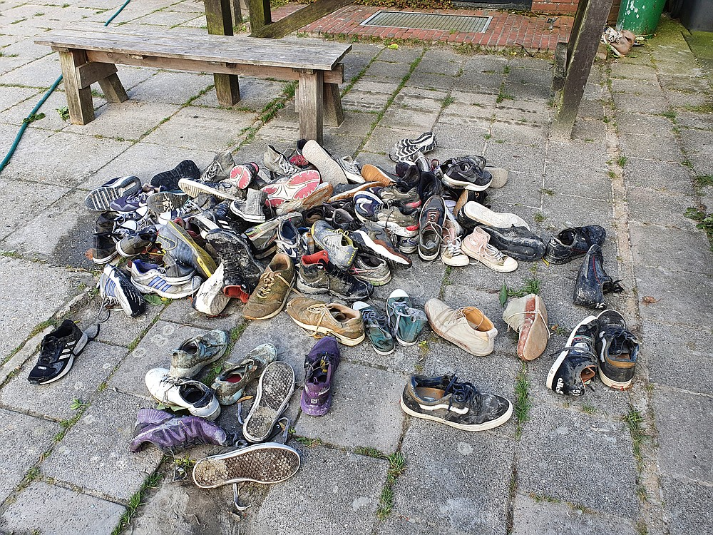 Guide Harm Jan Wilbrink keeps old shoes for mud walking at his foundation in Paesens. (Courtesy of Selina Kok)
