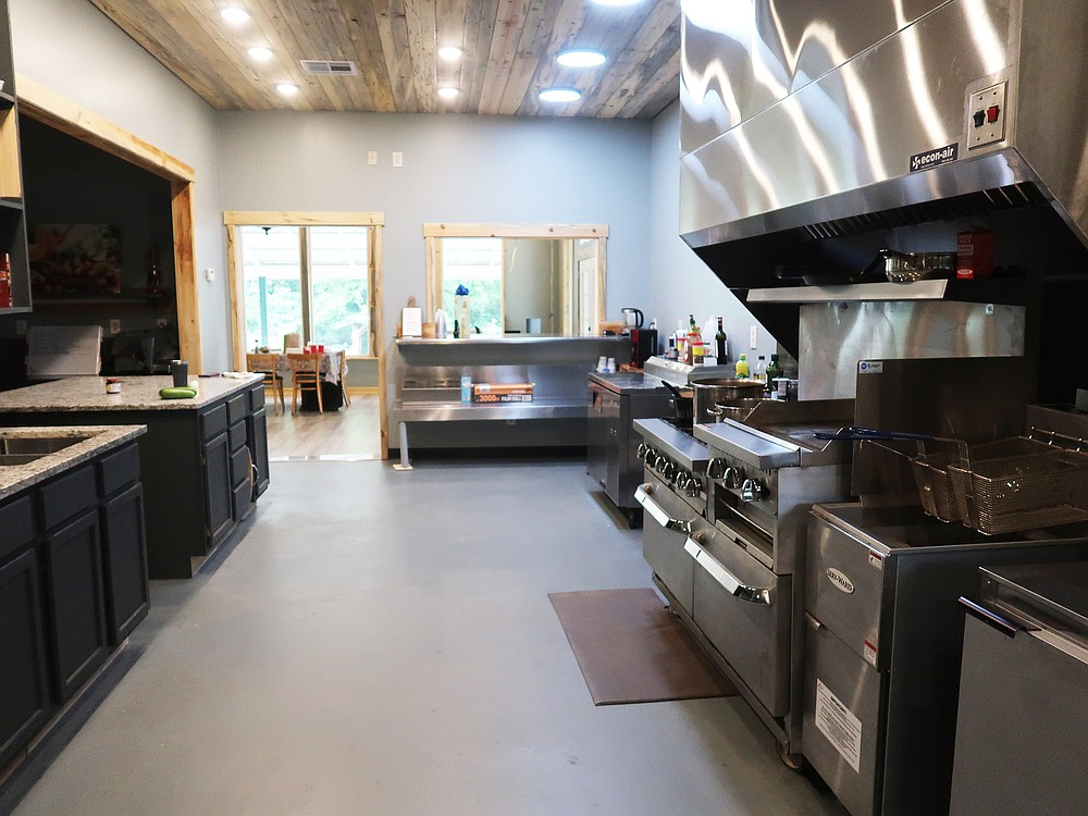 The professional kitchen at Urbana Farmstead produces prepared foods for the farm store and hosts classes in cooking and preserving herbs and vegetables. (Special to the Democrat-Gazette/Janet B. Carson)
