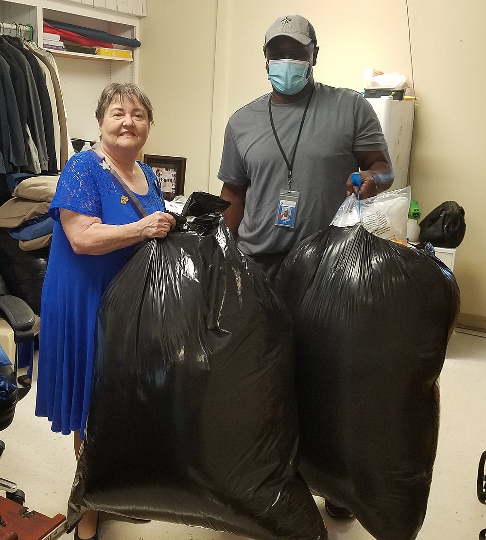The veterans' donation room at SFH. The pillows were delivered in large bags. Assisting Jerrie Jones unloading is SFH volunteer Alvin White of Pulaski Tech. Photo is courtesy of Beatty-Krout. - Submitted photo