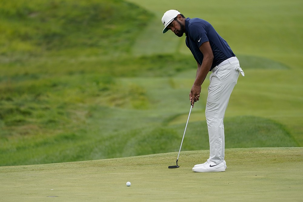 Tony Finau putt on the 17th green in the second round of the Northern Trust Golf Tournament, Friday August 20, 2021, at Liberty National Golf Course in Jersey City, NJ (AP Photo / John Minchillo)