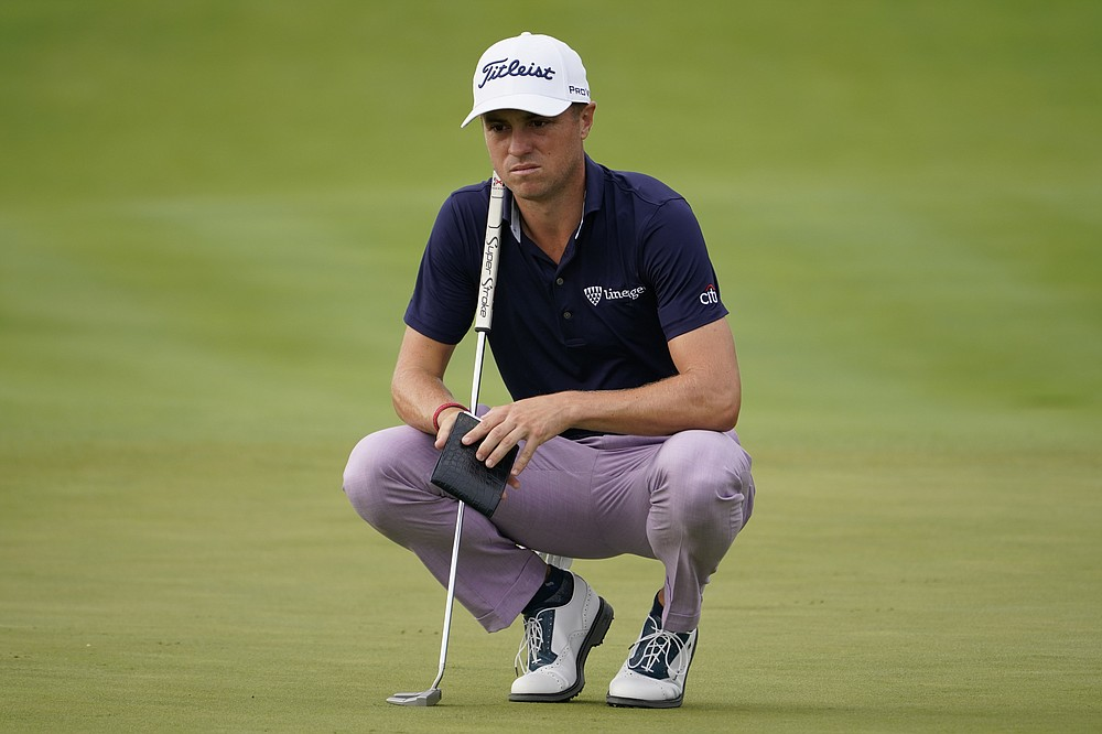 Justin Thomas reads the 12th green before moving on to the second round of the Northern Trust Golf Tournament on Friday August 20, 2021 at Liberty National Golf Course in Jersey City, NJ (AP Photo / John Minchillo)