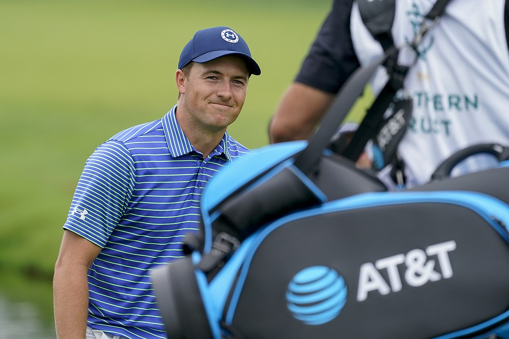 Jordan Spieth smiles after hopping out of the rough on the sixth green to complete his second straight eagle for the day in the second round of the Northern Trust Golf Tournament on Friday August 20, 2021 at Liberty National Golf Course in Jersey City, NJ (AP Photo / John Minchillo)