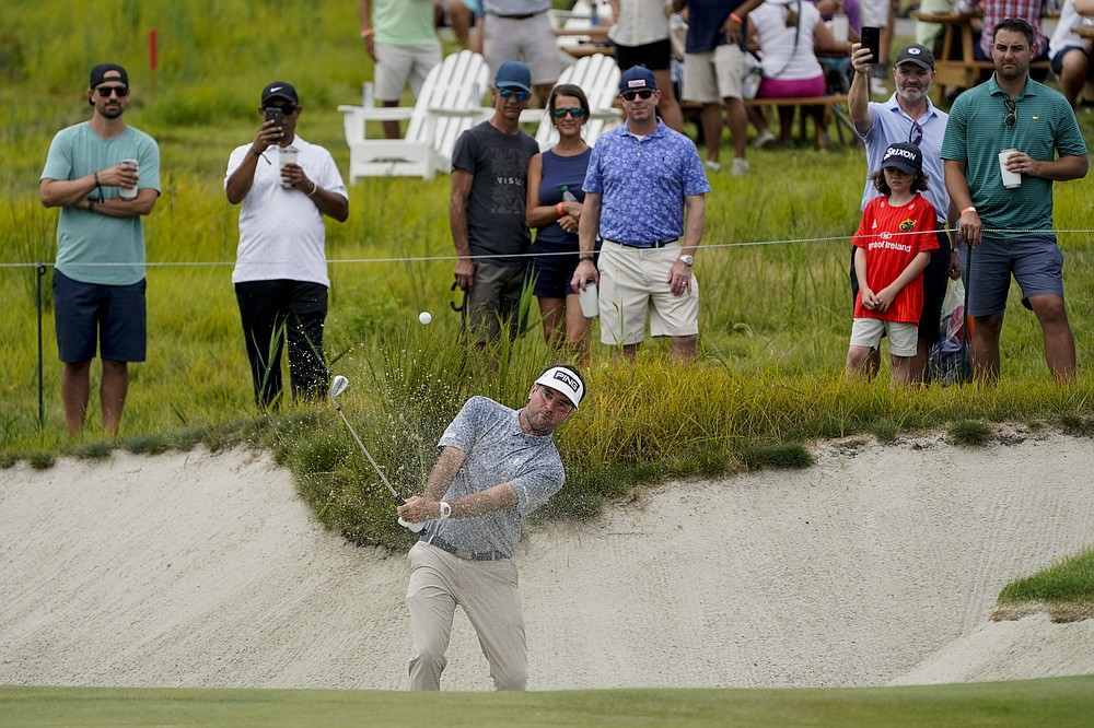 Bubba Watson hits a sand trap on the 13th green in the second round of the Northern Trust Golf Tournament, Friday August 20, 2021, at Liberty National Golf Course in Jersey City, NJ (AP Photo / John Minchillo)