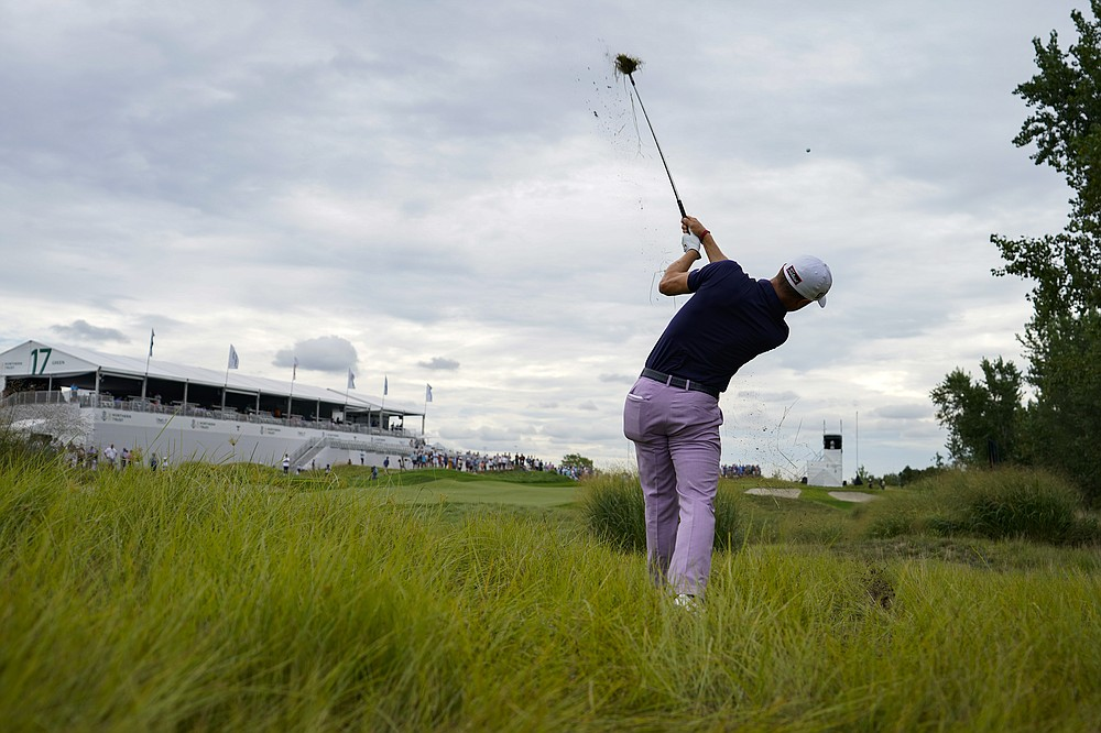 Justin Thomas hits the rough on the 17th hole in the second round of the Northern Trust Golf Tournament, Friday August 20, 2021, at Liberty National Golf Course in Jersey City, NJ (AP Photo / John Minchillo)
