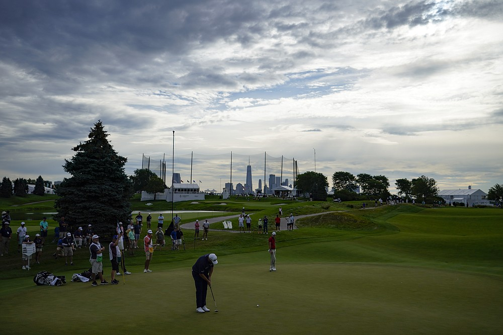 Shane Lowry of Ireland putt on the third green in the second round of the Northern Trust Golf Tournament on Friday August 20, 2021 at Liberty National Golf Course in Jersey City, NJ (AP Photo / John Minchillo)