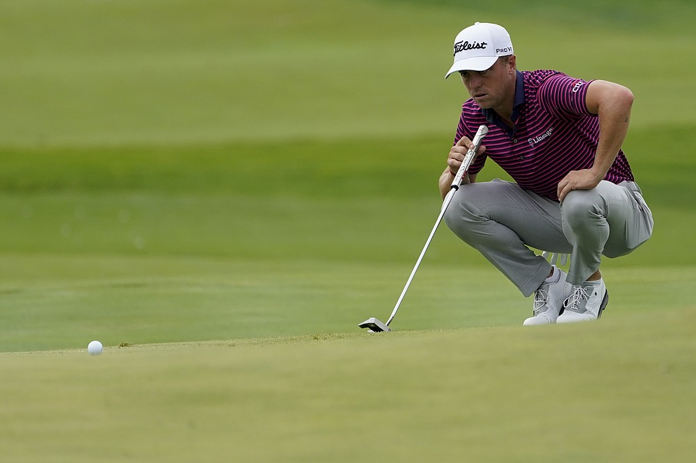Justin Thomas lines up a putt before sinking a birdie on the 10th green in the third round of the Northern Trust Golf Tournament, Saturday August 21, 2021, at Liberty National Golf Course in Jersey City, NJ (AP Photo / John Minchillo)