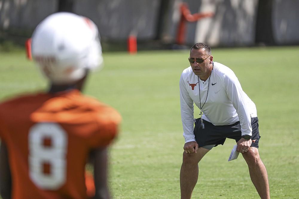 Texas head coach Steve Sarkisian watches his players run drills during an NCAA college football practice Saturday, Aug. 7, 2021, in Austin, Texas. (Aaron E. Martinez /Austin American-Statesman via AP)