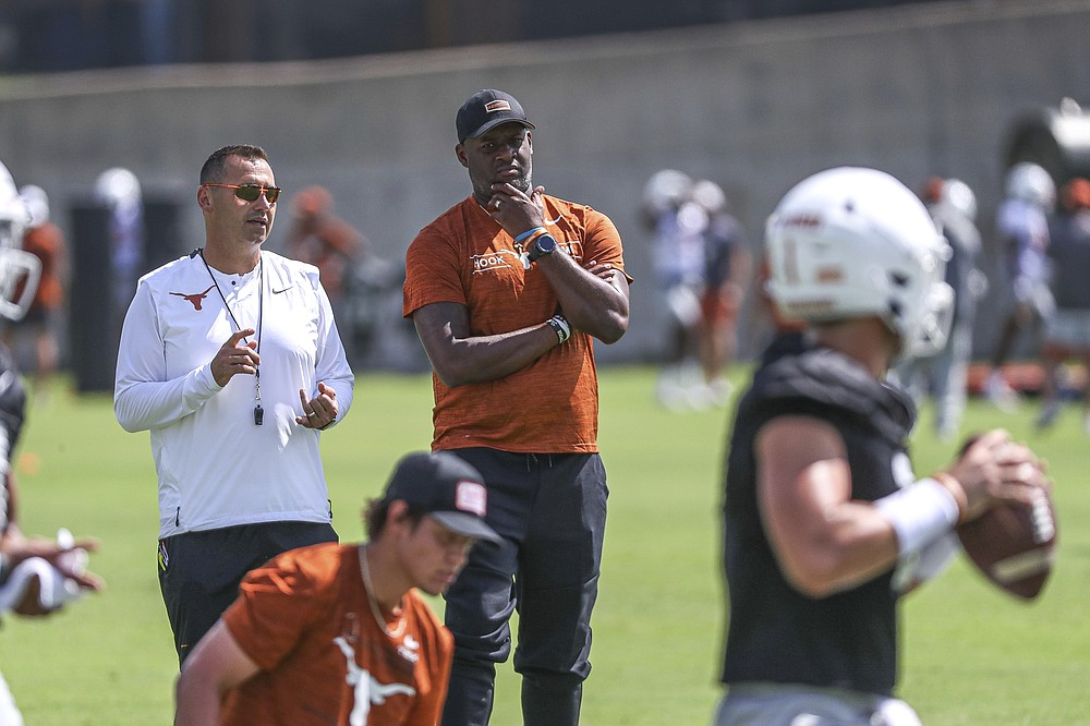 Texas head coach Steve Sarkisian, top left, is joined at practice by former Texas, Tennessee Titans, and Philadelphia Eagles quarterback Vince Young during an NCAA college football practice Saturday, Aug. 7, 2021, in Austin, Texas. (Aaron E. Martinez /Austin American-Statesman via AP)