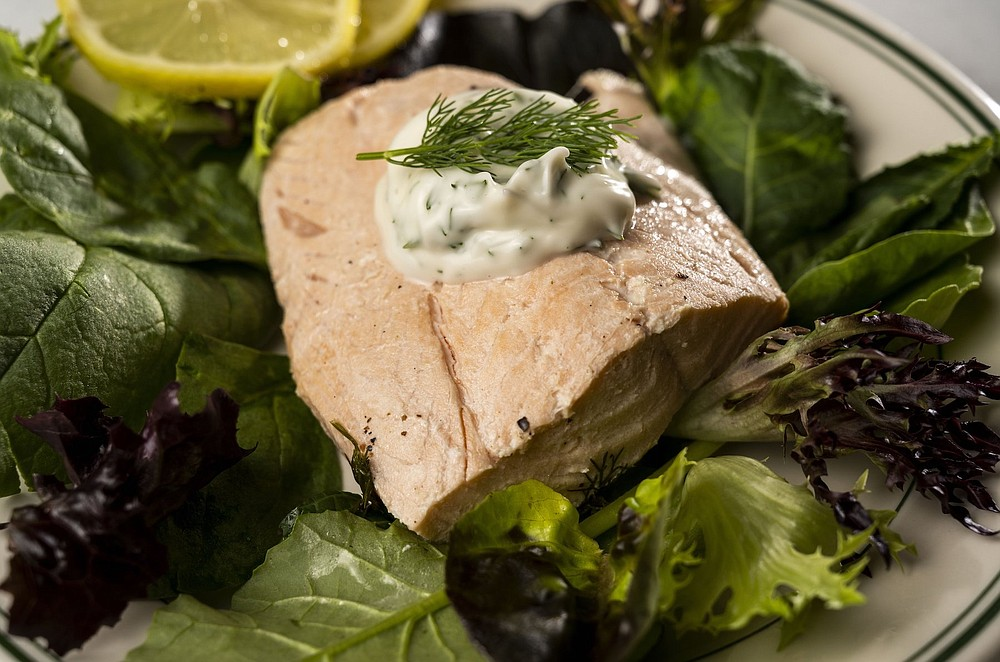 Poached Salmon with a dill mayo sauce on a bed of greens (TNS/St. Louis Post-Dispatch/Colter Peterson)