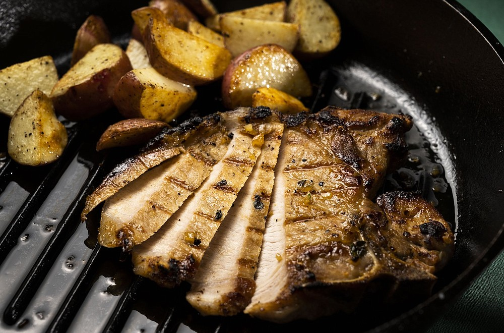 Easy Honey Garlic Pork Chops with pan fried potatoes (TNS/St. Louis Post-Dispatch/Colter Peterson)