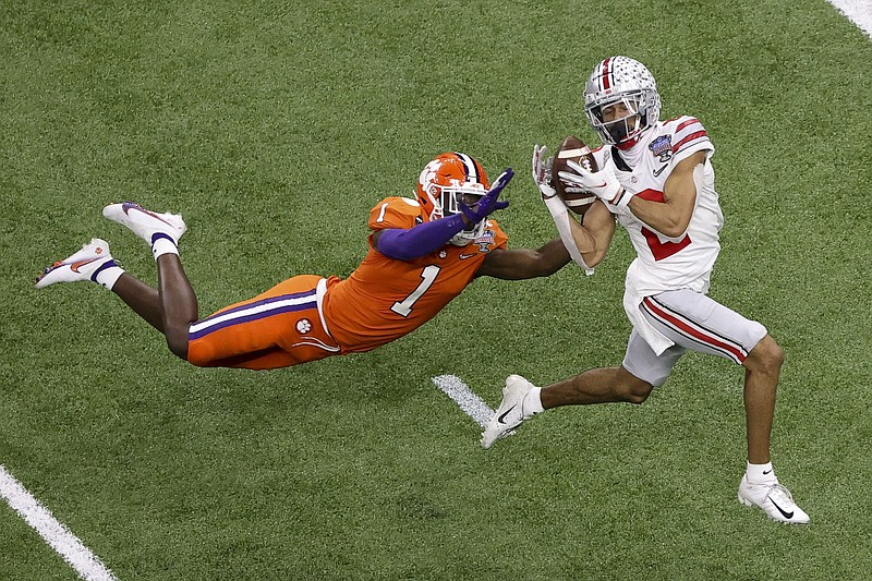 Ohio State wide receiver Chris Olave catches a touchdown pass in front of Clemson cornerback Derion Kendrick during the second half of the Sugar Bowl in New Orleans on Jan. 1. Clemson's conference, the ACC, and Ohio State's conference, the Big Ten, announced an alliance together and with the Pac-12. - Photo by Butch Dill of The Associated Press