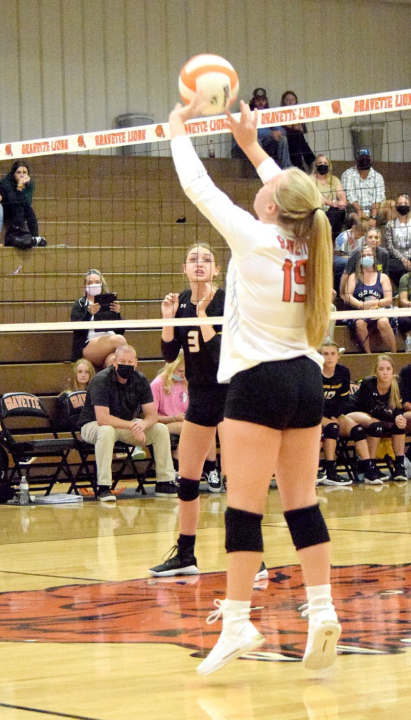 Westside Eagle Observer/MIKE ECKELS  Paige Greer (19) passes the ball to a teammate setting up a hit back into Lady Tiger territory during the Thursday night Gravette-Prairie Grove varsity volleyball match at the Competition Gym in Gravette.