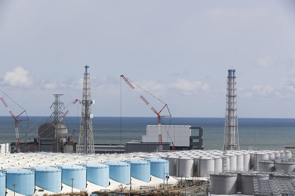 FILE - In this Feb. 27, 2021, file photo, the Pacific Ocean looks over nuclear reactor units of No. 3, left, and 4 at the Fukushima Daiichi nuclear power plant in Okuma town, Fukushima prefecture, northeastern Japan. (AP Photo/Hiro Komae, File)