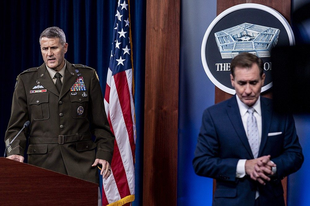 U.S. Army Major Gen. William Taylor, Joint Staff Operations, left, accompanied by Pentagon spokesman John Kirby, right, takes the podium to speak during a briefing at the Pentagon in Washington, Wednesday, Aug. 25, 2021. (AP Photo/Andrew Harnik)