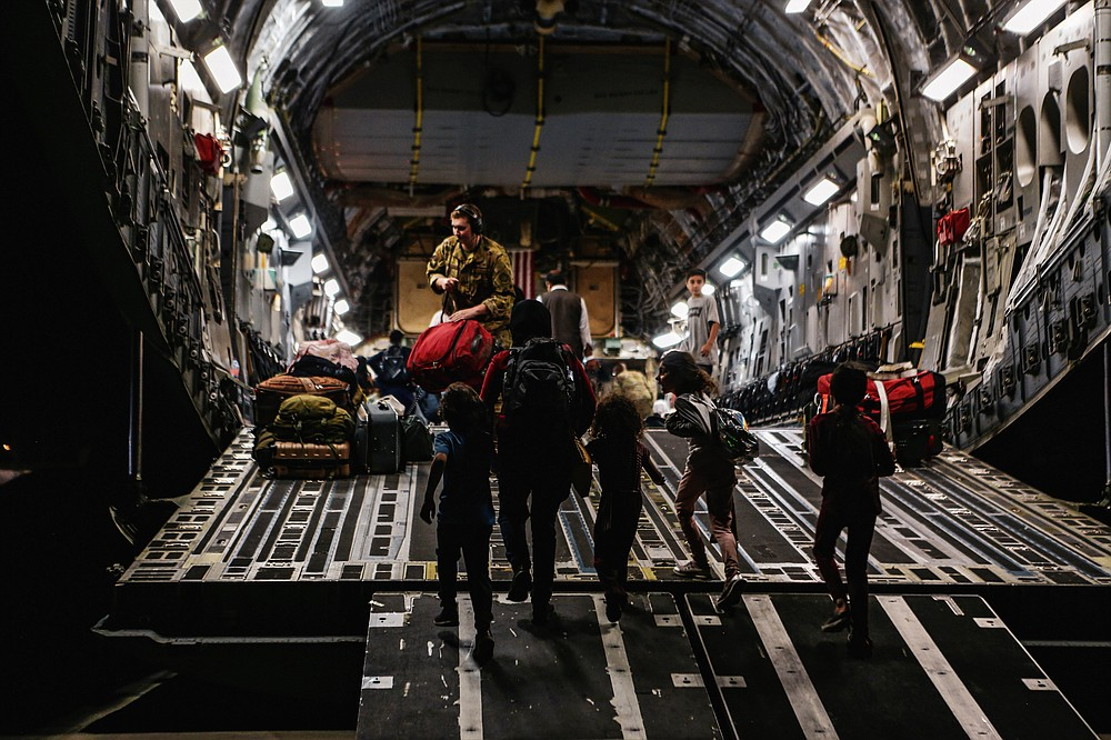 In this image provided by the U.S. Marine Corps, board a Boeing C-17 Globemaster III, at Hamid Karzai International Airport, Kabul, Afghanistan, Monday, Aug. 23, 2021. (Sgt. Isaiah Campbell/U.S. Marine Corps via AP)