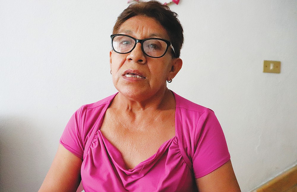 Marisela Ramirez, whose 25-year-old daughter Claudia Castillo died in the Aug. 25, 2011 attack on the Casino Royale, speaks during an interview in Monterrey, Mexico, Wednesday, Aug. 18, 2021. Ten years after the brutal attack in northeastern Mexico, the relatives of the 52 victims question the actions of the authorities to deliver justice. (AP Photo/Marcos Martinez Chacon)