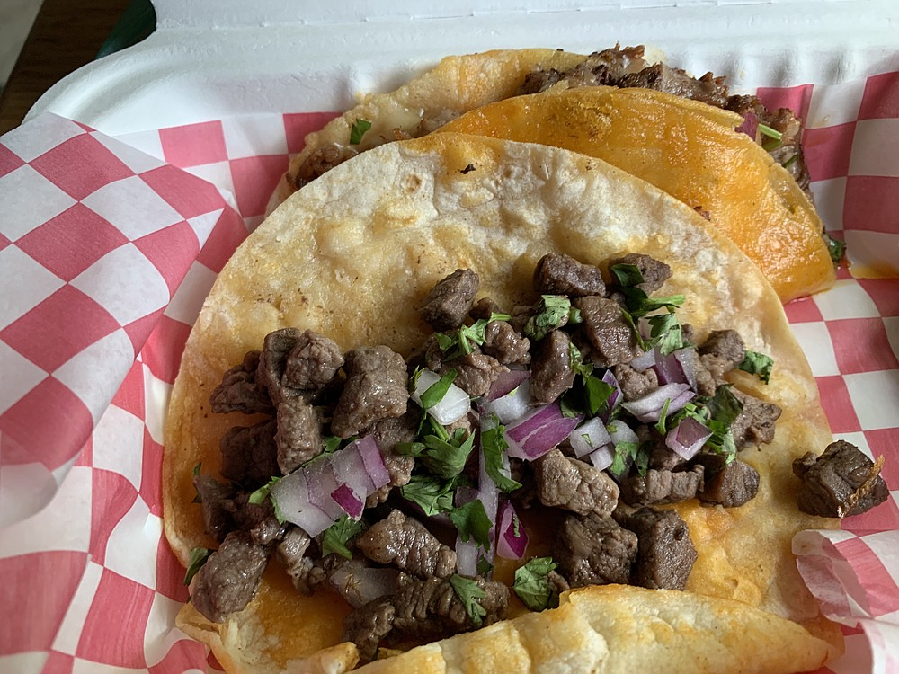 Lili's Mexican Street Food truck Carne Asada (foreground) and Quesabirria tacos perhaps come from somewhat swankier streets. (Arkansas Democrat-Gazette/Eric E. Harrison)