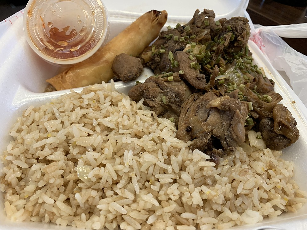 The Chicken Adobo combo from the Yum Yum Filipino Fusion food truck included one lumpia, fried rice and stir-fried pancit noodles (not shown). (Arkansas Democrat-Gazette/Eric E. Harrison)