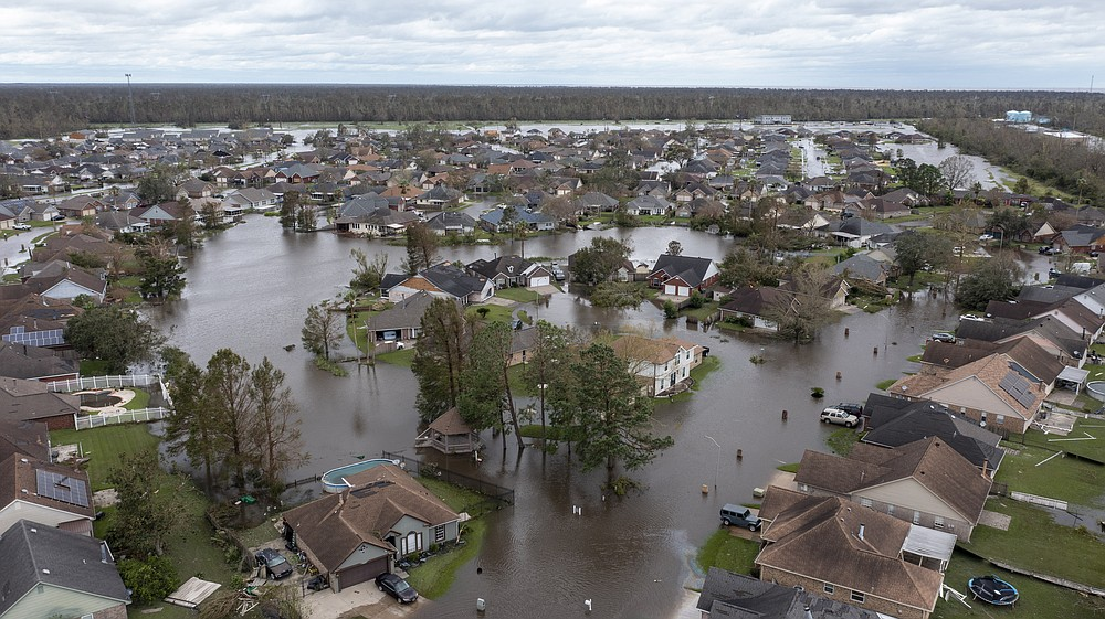 Flooded streets and homes are shown in the Spring Meadow subdivision in LaPlace, La., after Hurricane Ida moved through Monday, Aug. 30, 2021. Hard-hit LaPlace is squeezed between the Mississippi River and Lake Pontchartrain. (AP Photo/Steve Helber)